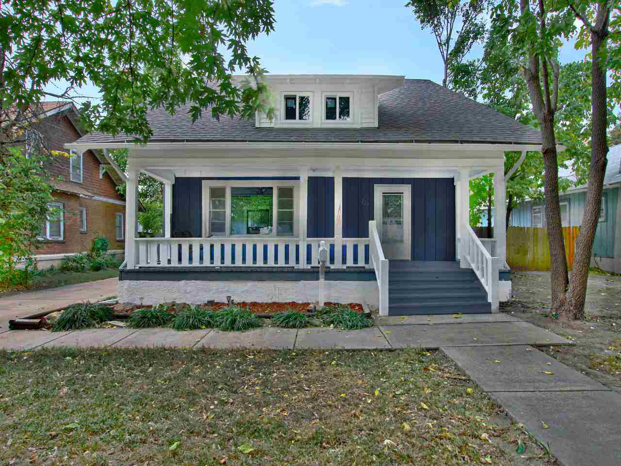 Welcome home to this lovely Uptown bungalow located just blocks from College Hill! This home has bee