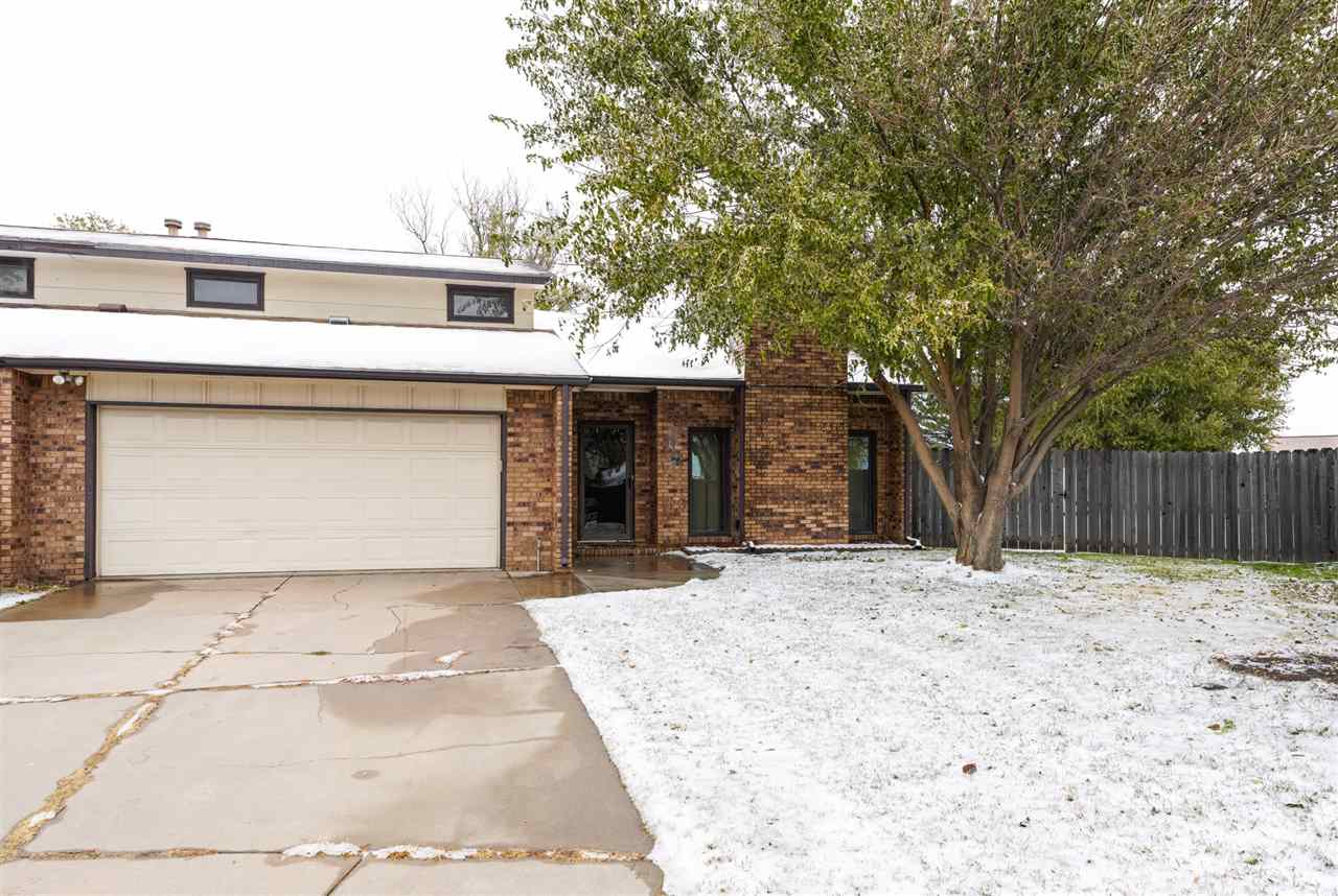 What a rare find in West Wichita! You will love all that this twin home has to offer! Situated on a