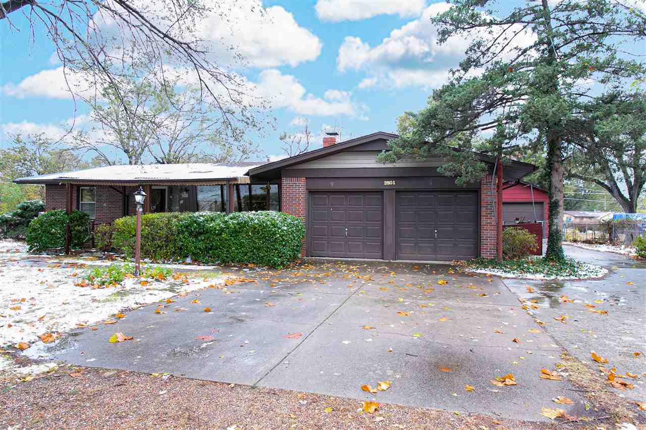 Welcome home to this Mid Century full brick ranch on almost 1/2 acre lot. Original hardwood floors i