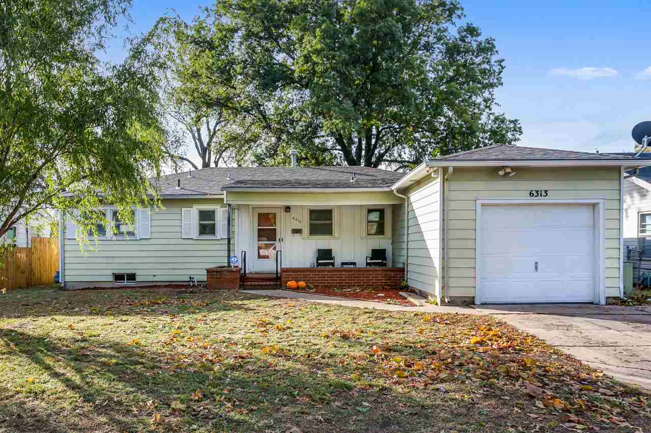 Look at this spacious 3 bedroom Mid-Century home with a large family room, a park like view from the