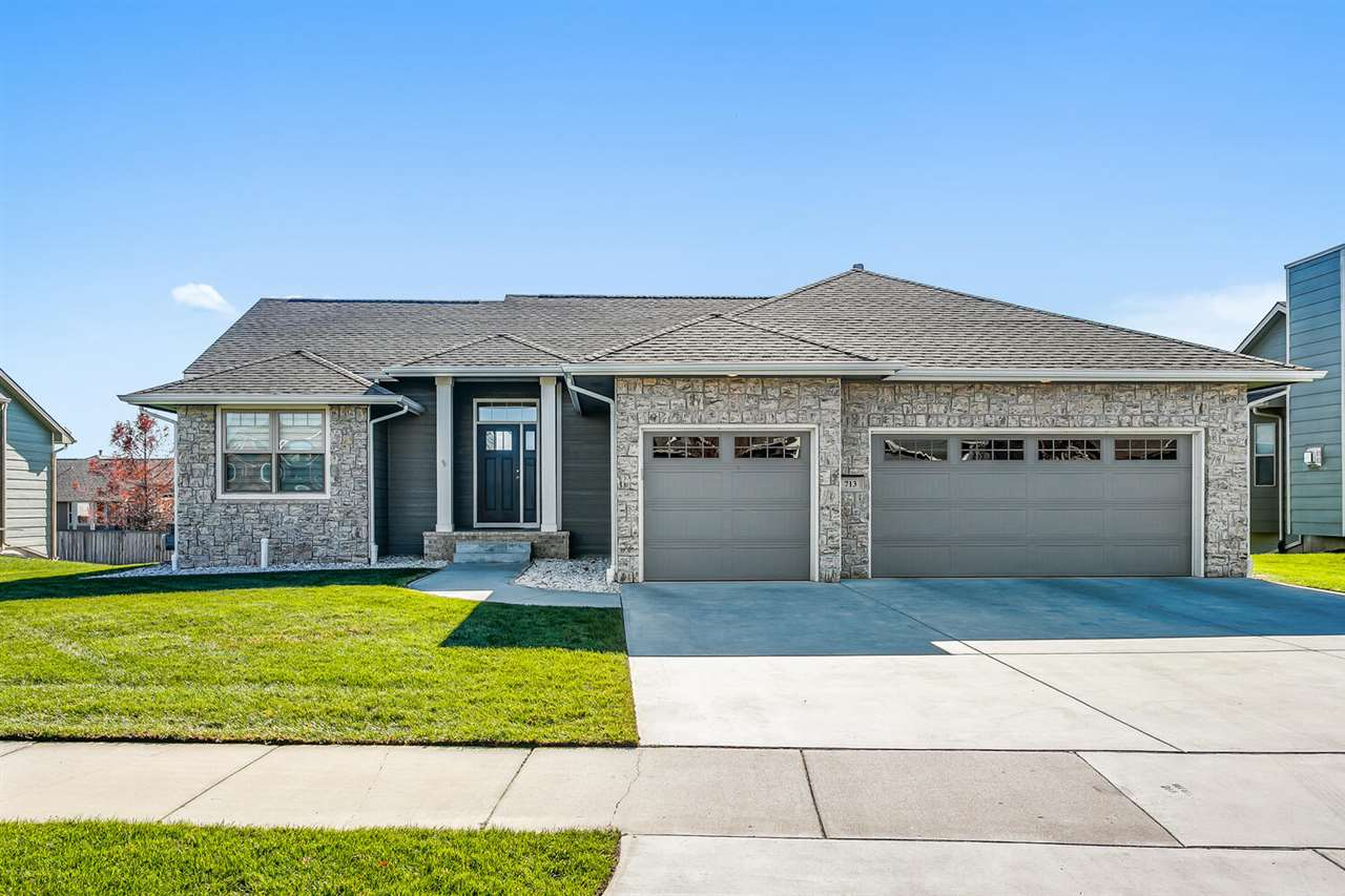 Wow this Cornerstone home shows like brand new! Welcome home to 713 W Slate Andover, KS. This 5 bedr