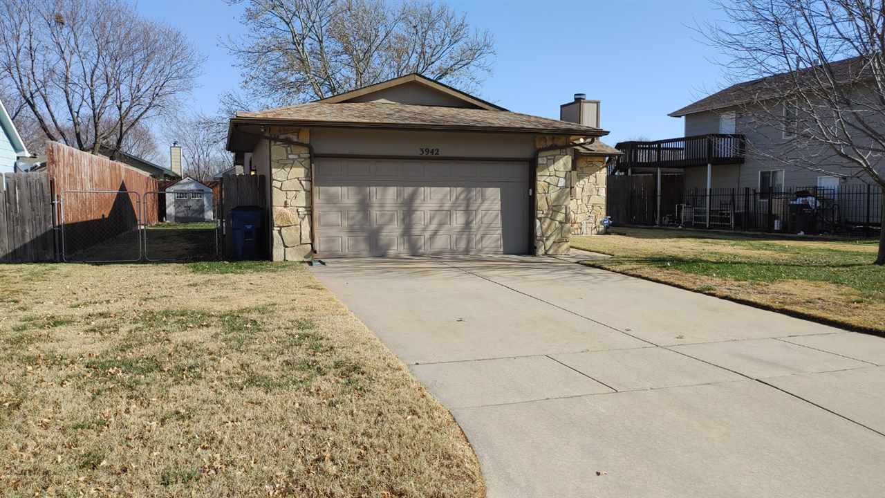 Come check out this well maintained 3 bedroom 2 bath home. It features a stone fireplace (gas) and beamed ceilings along with 2 bedrooms and a bathroom on the main floor. In the basement you will find an additional bedroom and bathroom along with a 4th bonus room with closet and a family room. You will love the backyard landscaping with the 16ft x 16ft deck, 8ft tall privacy fencing and storage shed. This home is move in ready with a brand new hot water heater, newer sewer line, garage door opener and kitchen appliances included (range/oven, built in microwave, dishwasher and refrigerator) Call today for a private showing!