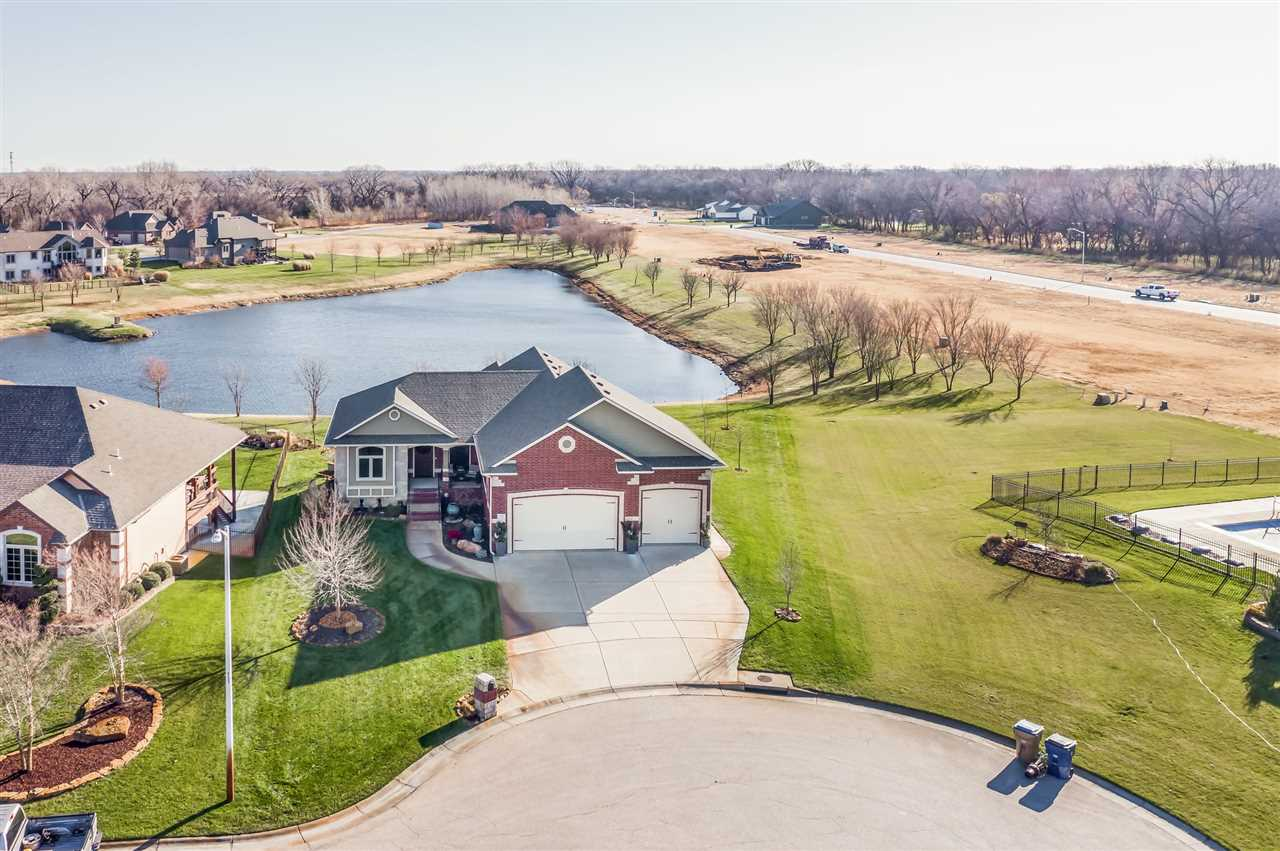 With beautiful water views and direct lake access, this stunning Haysville estate is your own person
