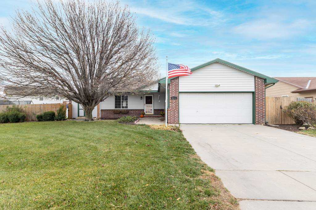 Tucked away on a quiet street in the Haysville School District, this beautiful three bedroom ranch h