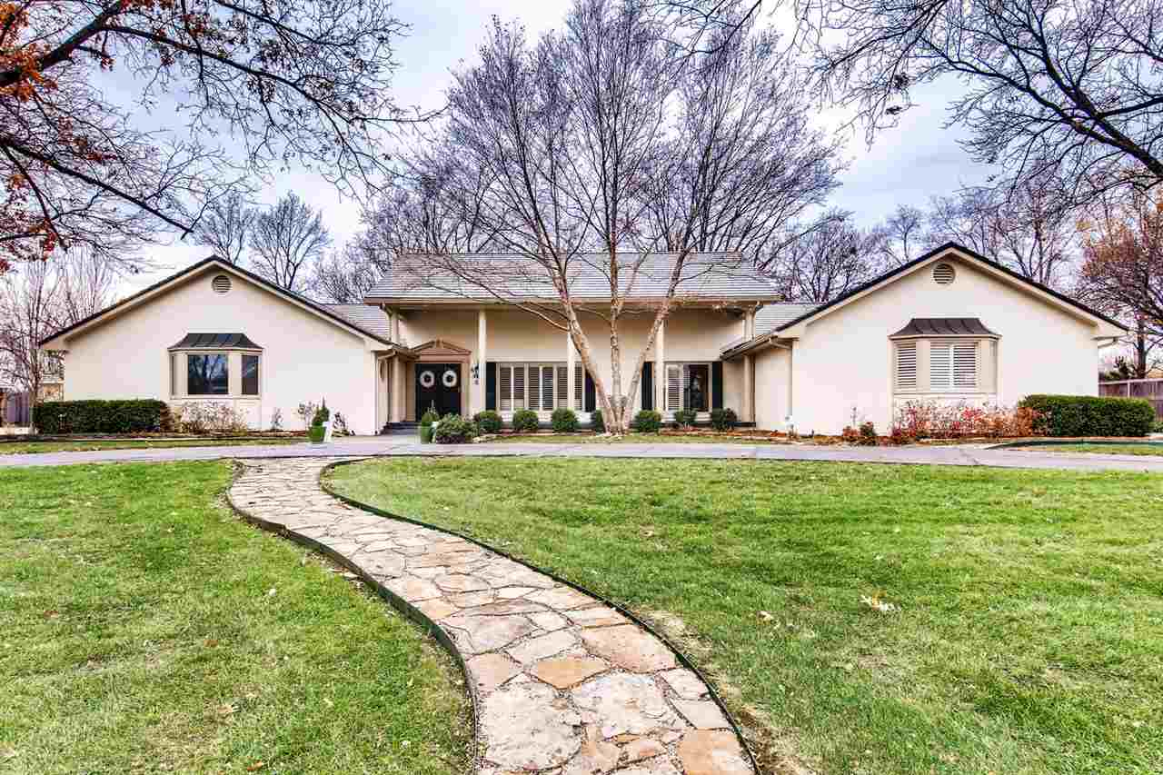 You will love coming home to this stunning sprawling ranch in the sought after Vickridge neighborhoo