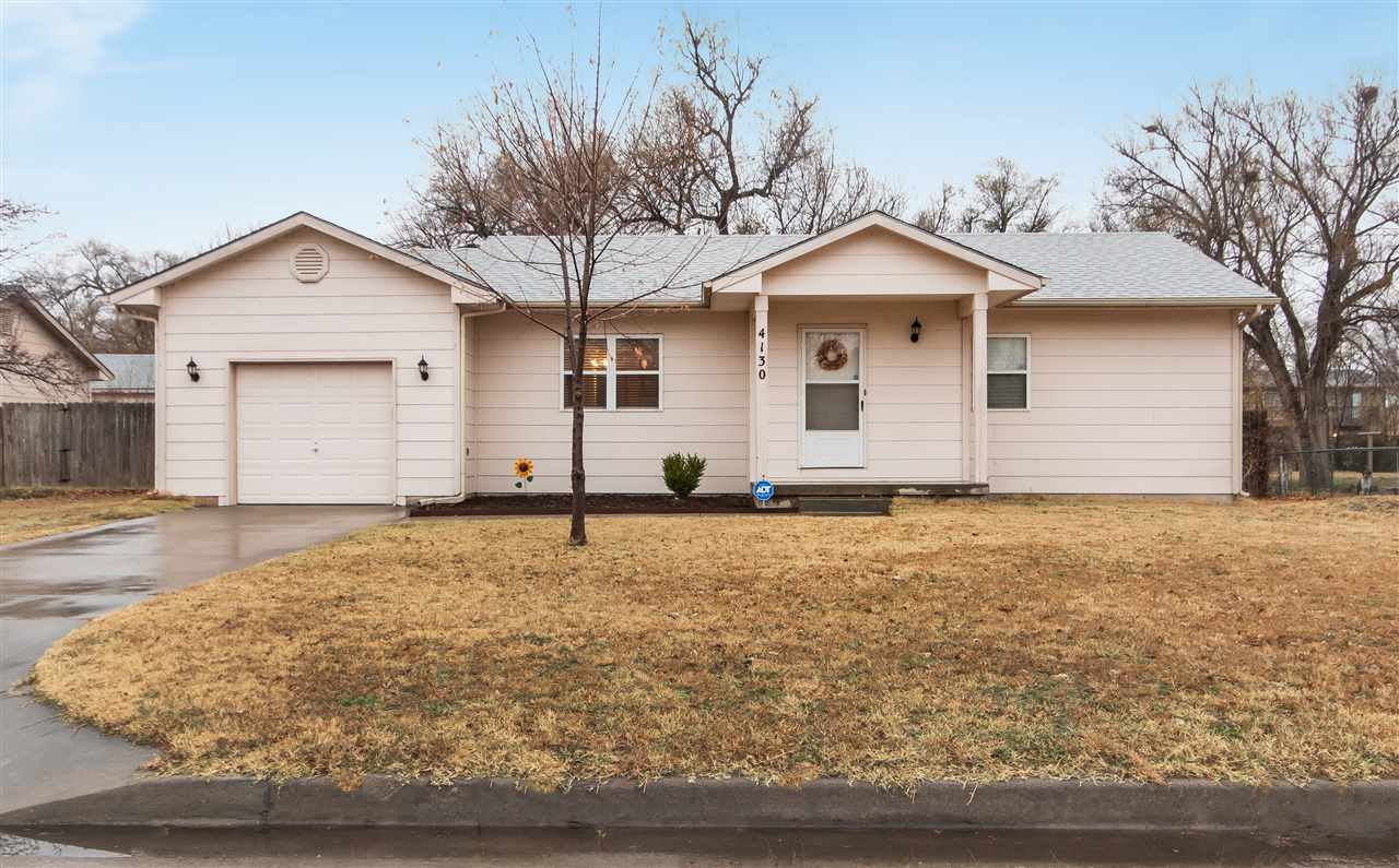 Absolutely charming home in West Wichita close to shopping and dining! This 4 bedroom, 1.5 bathroom