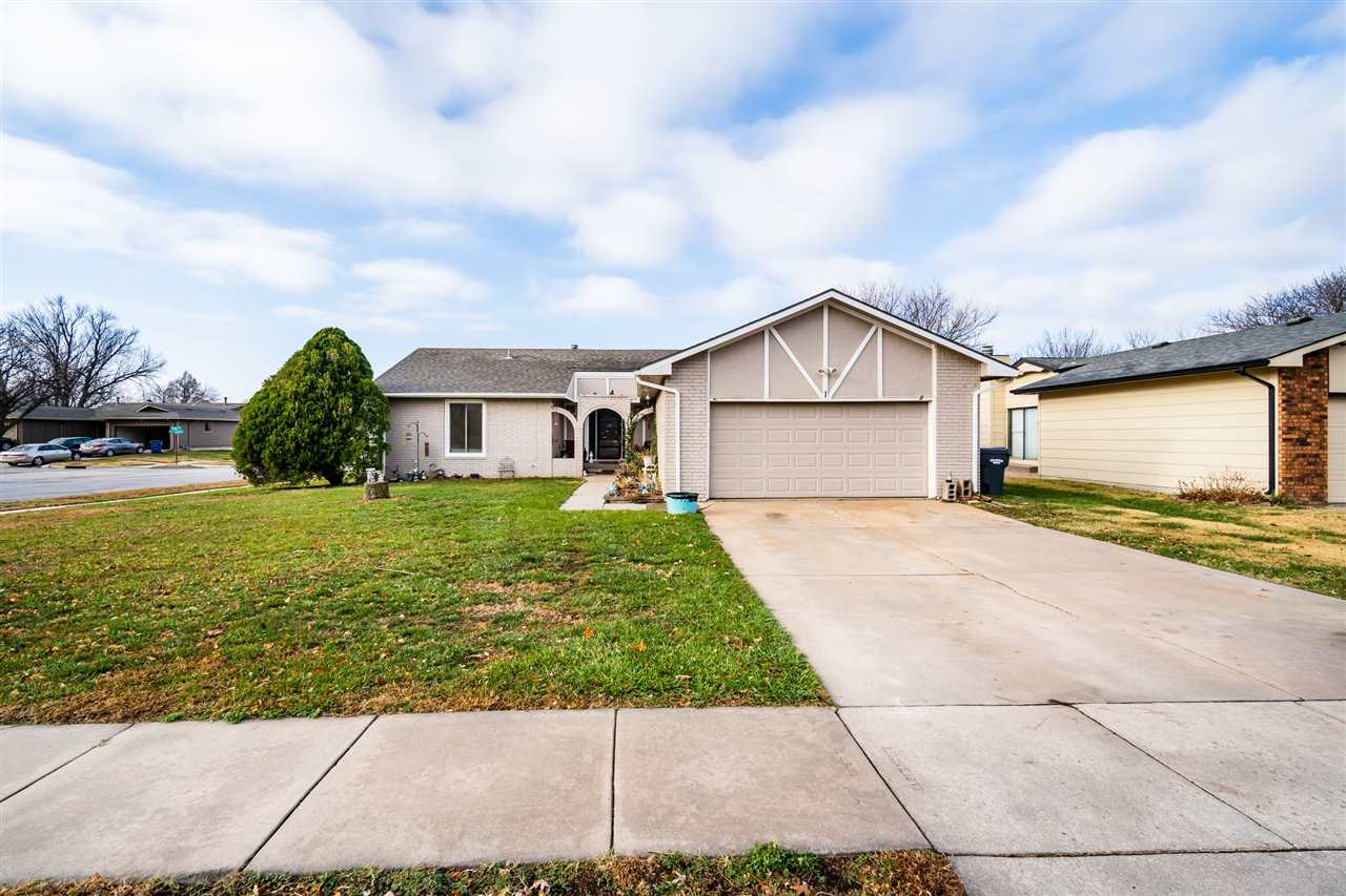 Great house conveniently located in Wichita located on a big corner lot. Open concept feel with lots