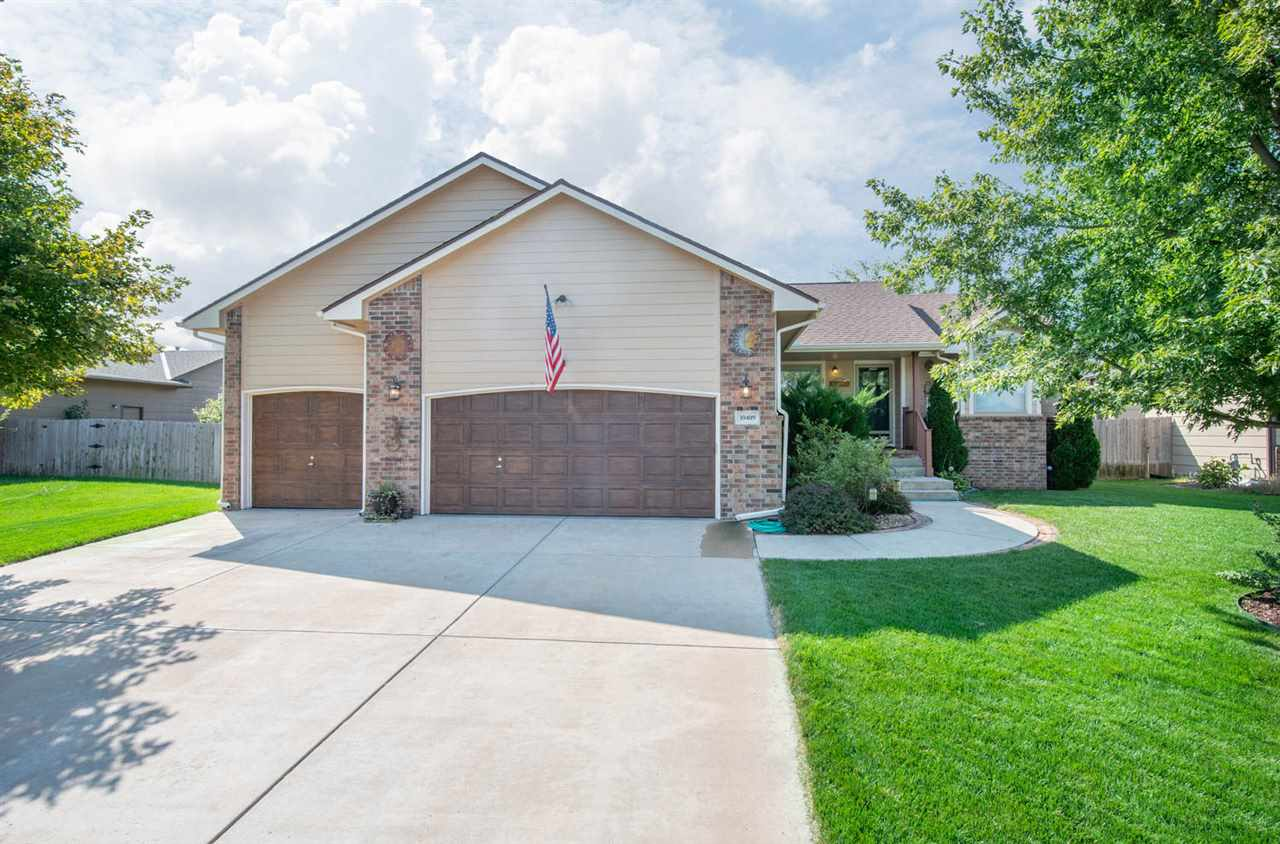 4 BED, 3 CAR GARAGE, RANCH HOME IN THE GODDARD DISTRICT SHOWCASING QUALITY UPGRADES! WALK INTO A LAR