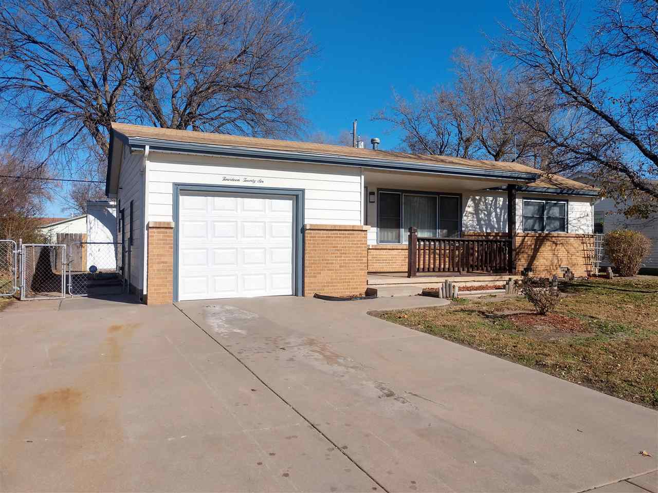 Move-in ready home in Southwest Wichita. Entering the home you'll notice the tasteful updates and cl