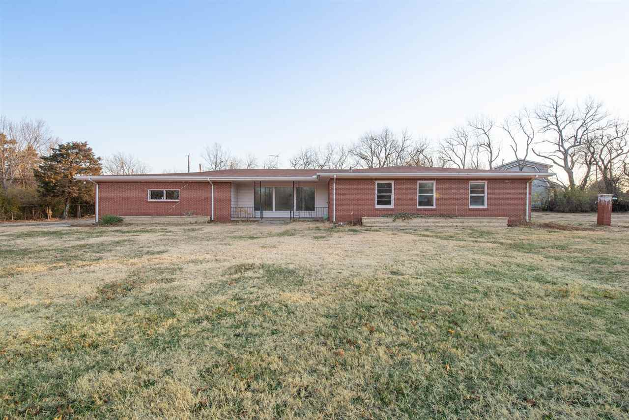 Northeast, Wichita rambler, also known as a ranch style house. Home has 3 living areas, wood burning
