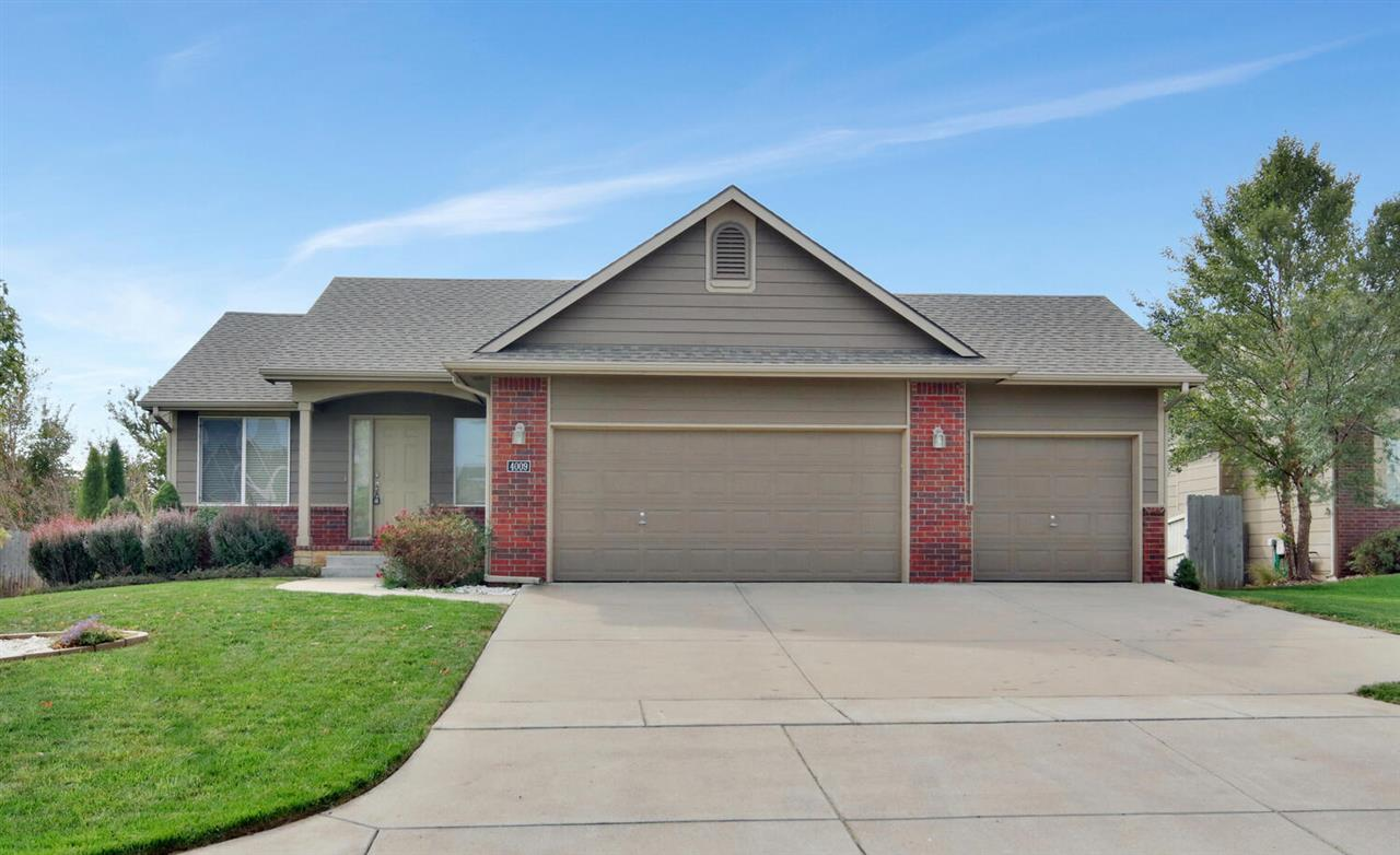 Fantastic home located in the desirable Hampton Lakes Addition.  Take advantage of Maize schools and