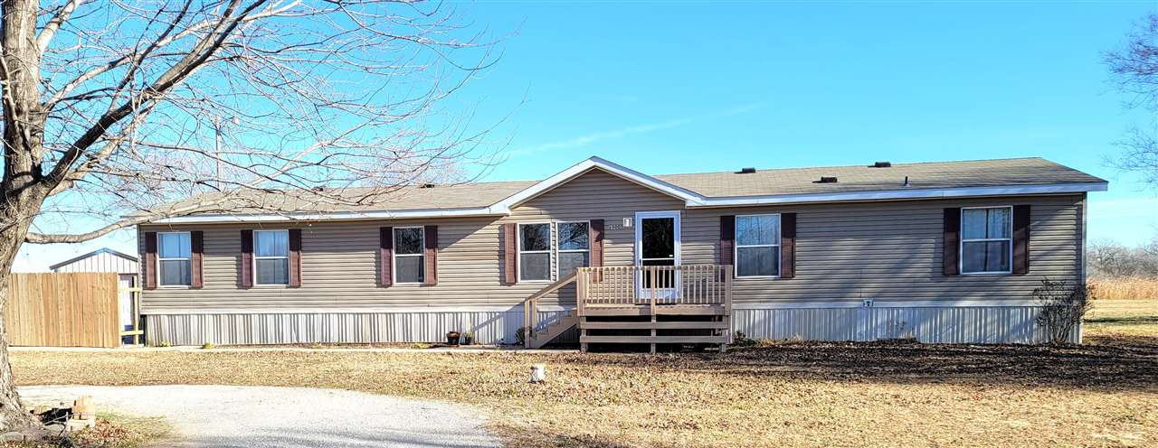 Opportunity for country living!  Offsite double wide manufactured home with split bedroom floorplan