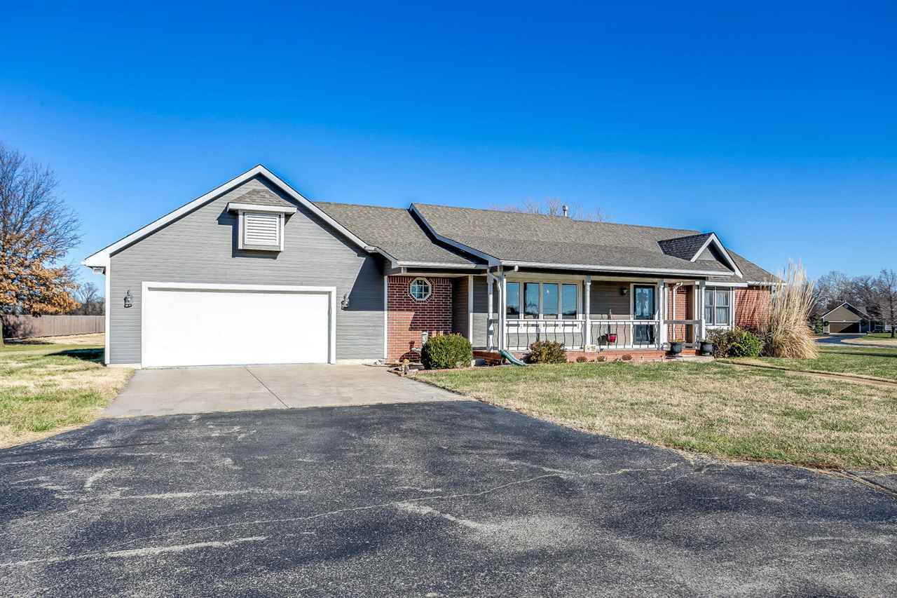 Welcome to this lovely Haysville home with Derby schools. Home is nestled on 2.77 acres with paved f