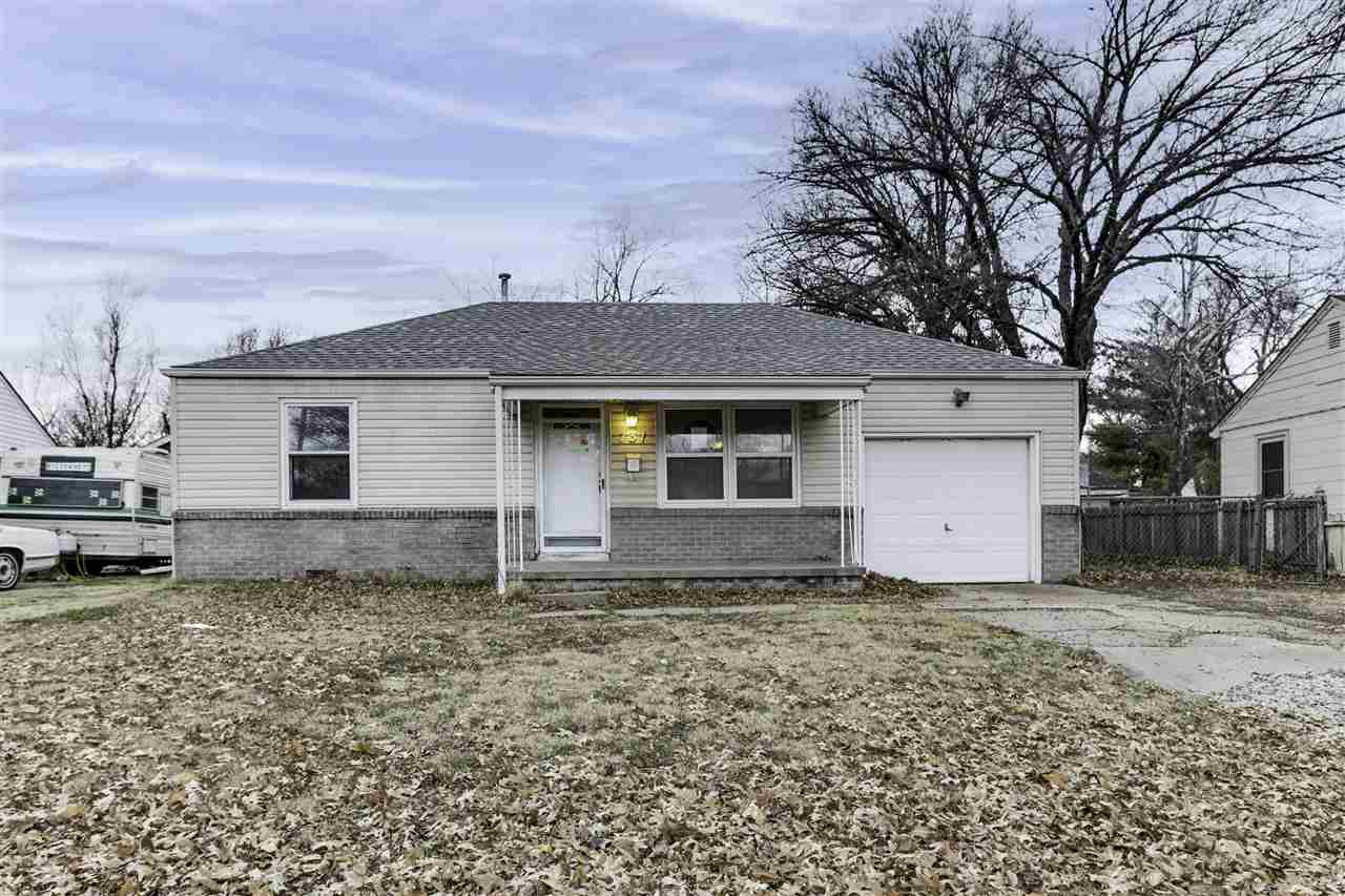 Lovely ranch home, move in ready located on a large lot! New carpet and paint throughout the home. T
