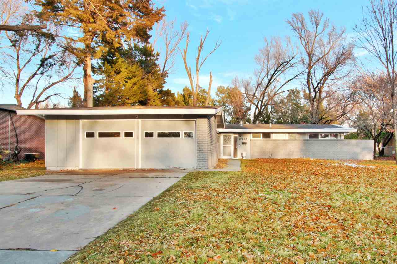 Darling home located on a half acre lot, backing up to the river in north Wichita.  Gorgeous river v
