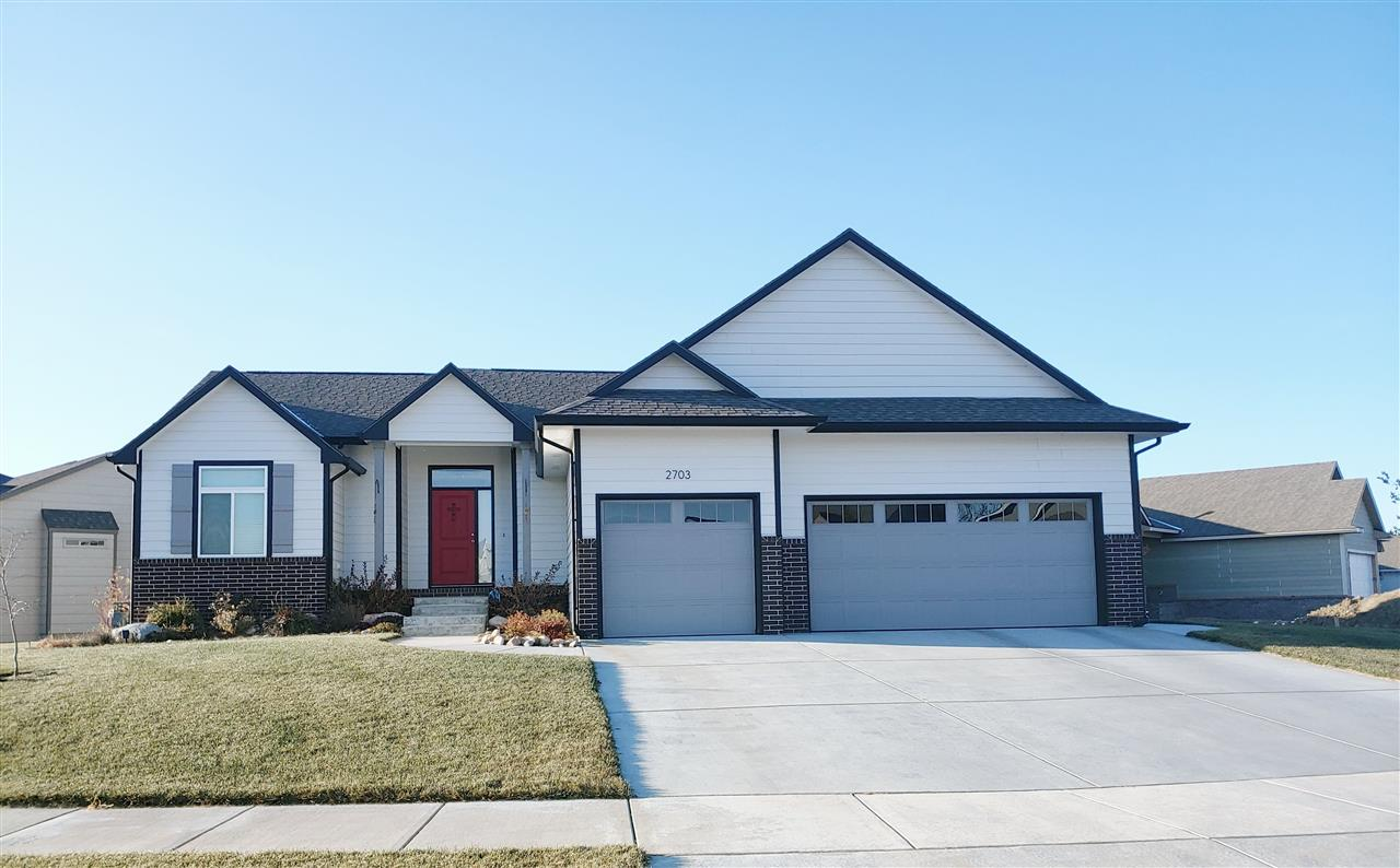Step into this beautiful open concept home with vaulted ceilings.  The layout is perfect for enterta