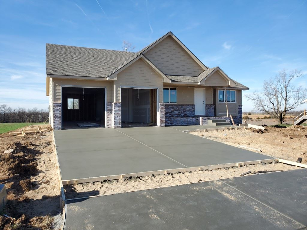 New build that will be completed late February to early March. Will include granite countertops, vaulted ceilings, wet bar, covered deck, oversized 3 car garage that measures 45 feet in depth. Low special taxes and the backyard opens up to large open field.