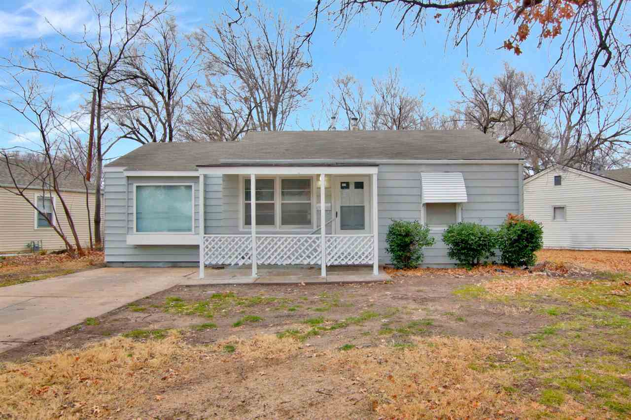 Two bedroom ranch with an extra 19 x 11.7 room for a family room or home office! Two full baths, fenced back yard (North side will have privacy fence in a couple of days).  Newly painted inside an out.  All appliances remain including washer and dryer.  Eating space in kitchen as sliding glass doors to new deck.