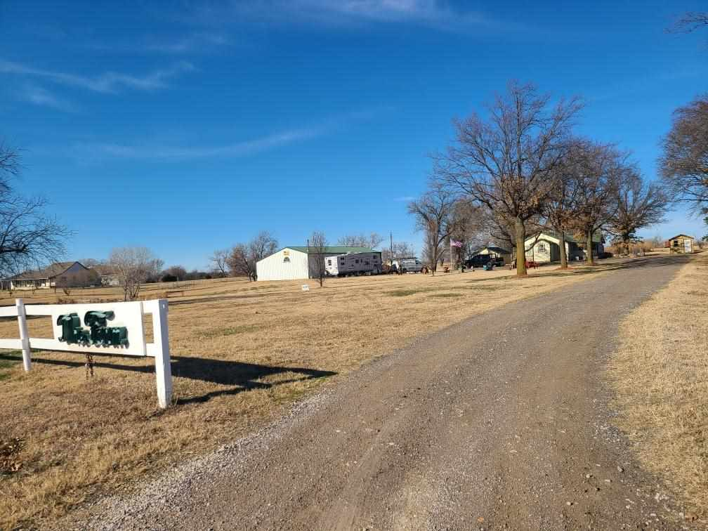 House on LAND! AND a Shop!!  Out by Lake Afton !  Must See!  4 bedrooms, 3 bathrooms, detached garage and out buildings! Beautiful Stocked Pond!  Mostly Fenced in area for Livestock :)  Must See! Open House this Sunday from 2-4pm.  Come See Me!!!