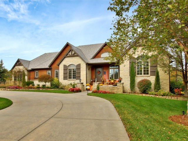 Stunning Flint Hills estate with limestone and cedar exterior, large circle drive with an oversized