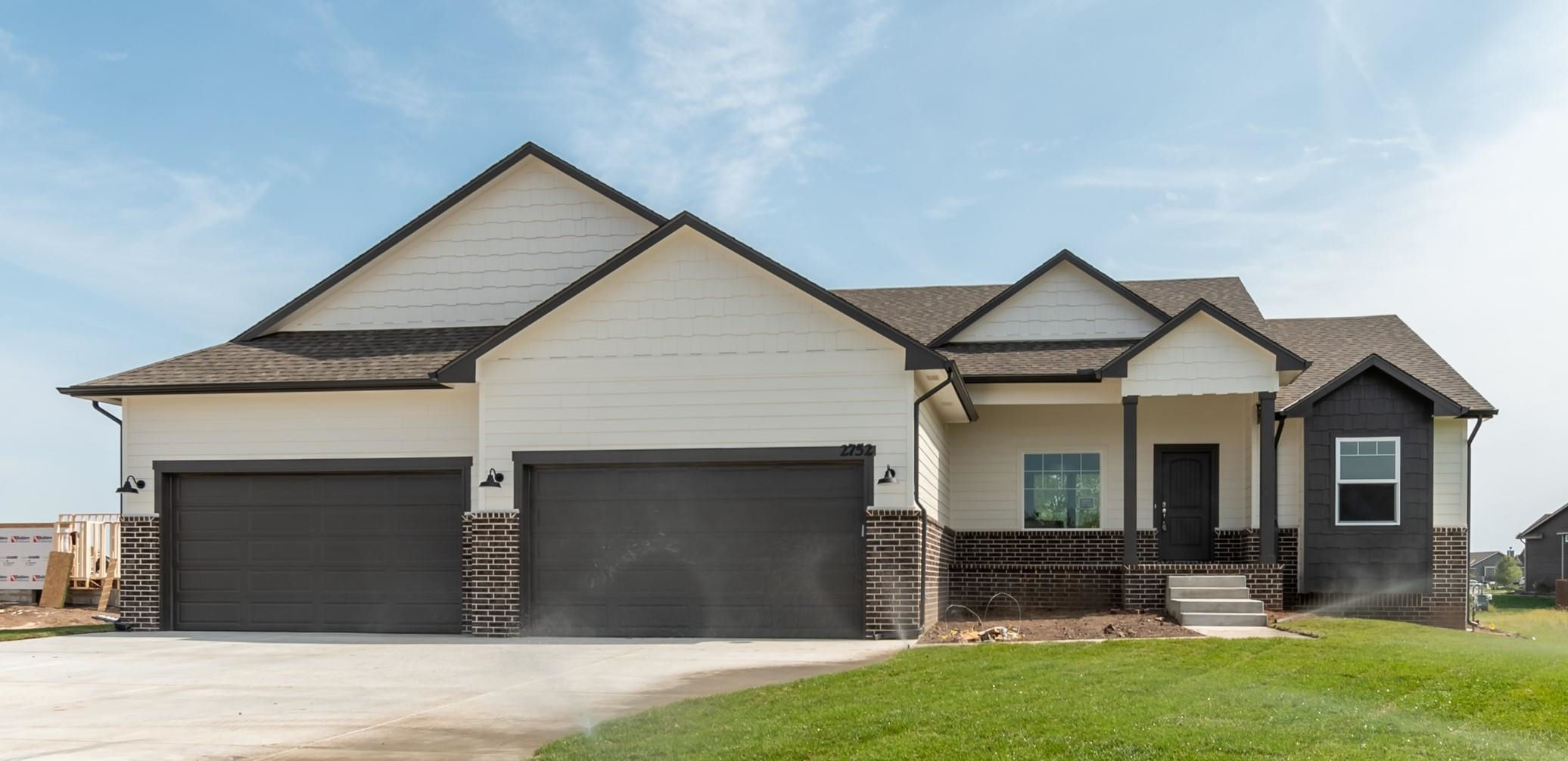 Another beautiful home designed by Miller Family Homes, Inc. This home features the ever-popular Sto
