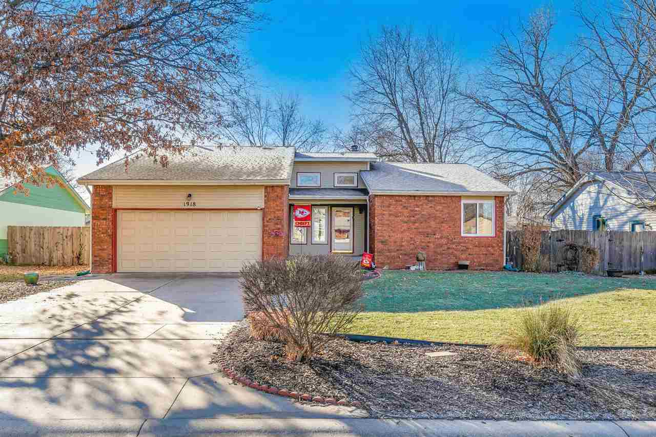 Perfectly located in NW Wichita, this Ranch welcomes you home. The spacious living room features a w