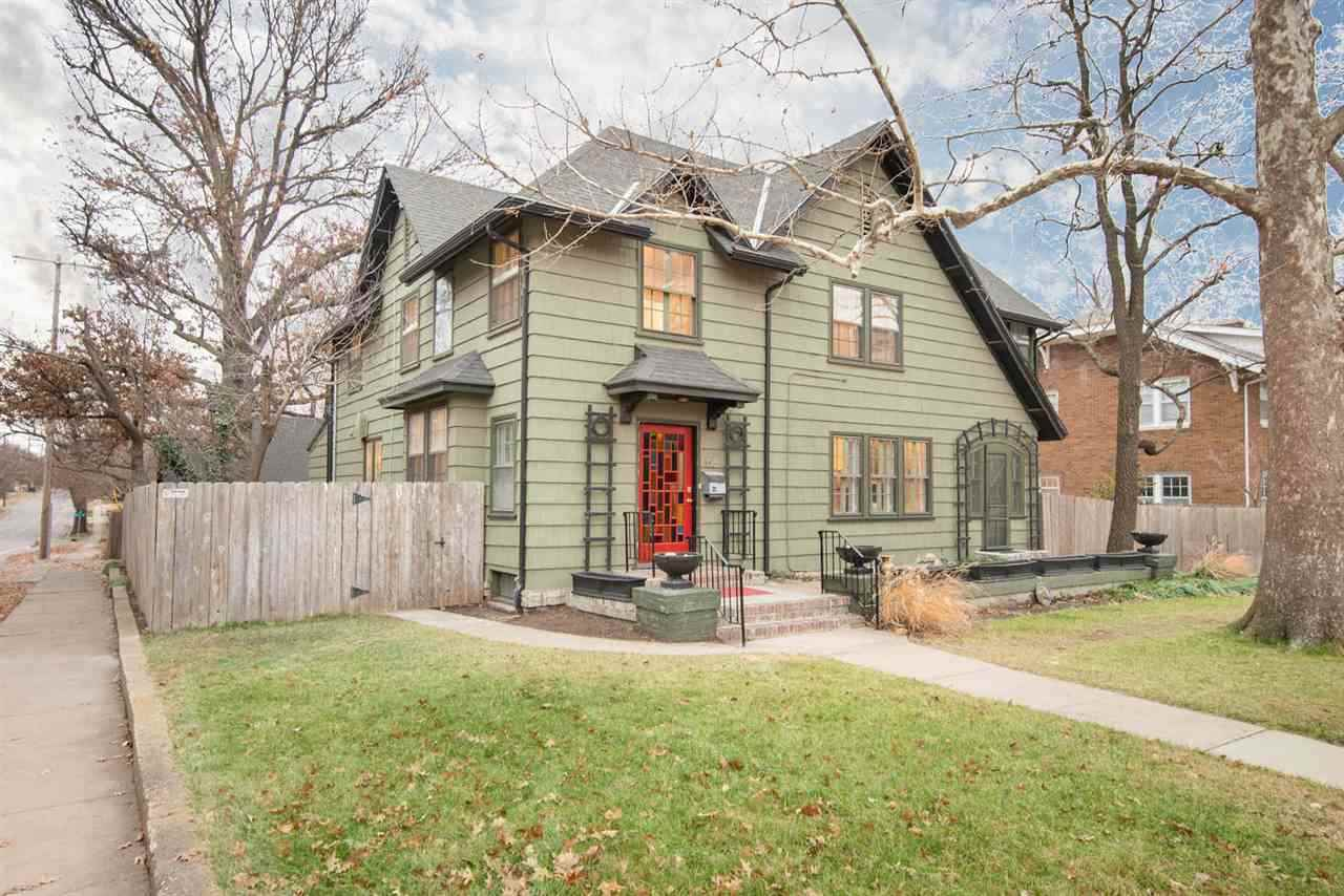Fall in love with this beautifully updated 1919 College Hill home. Where old world charm and craftsm