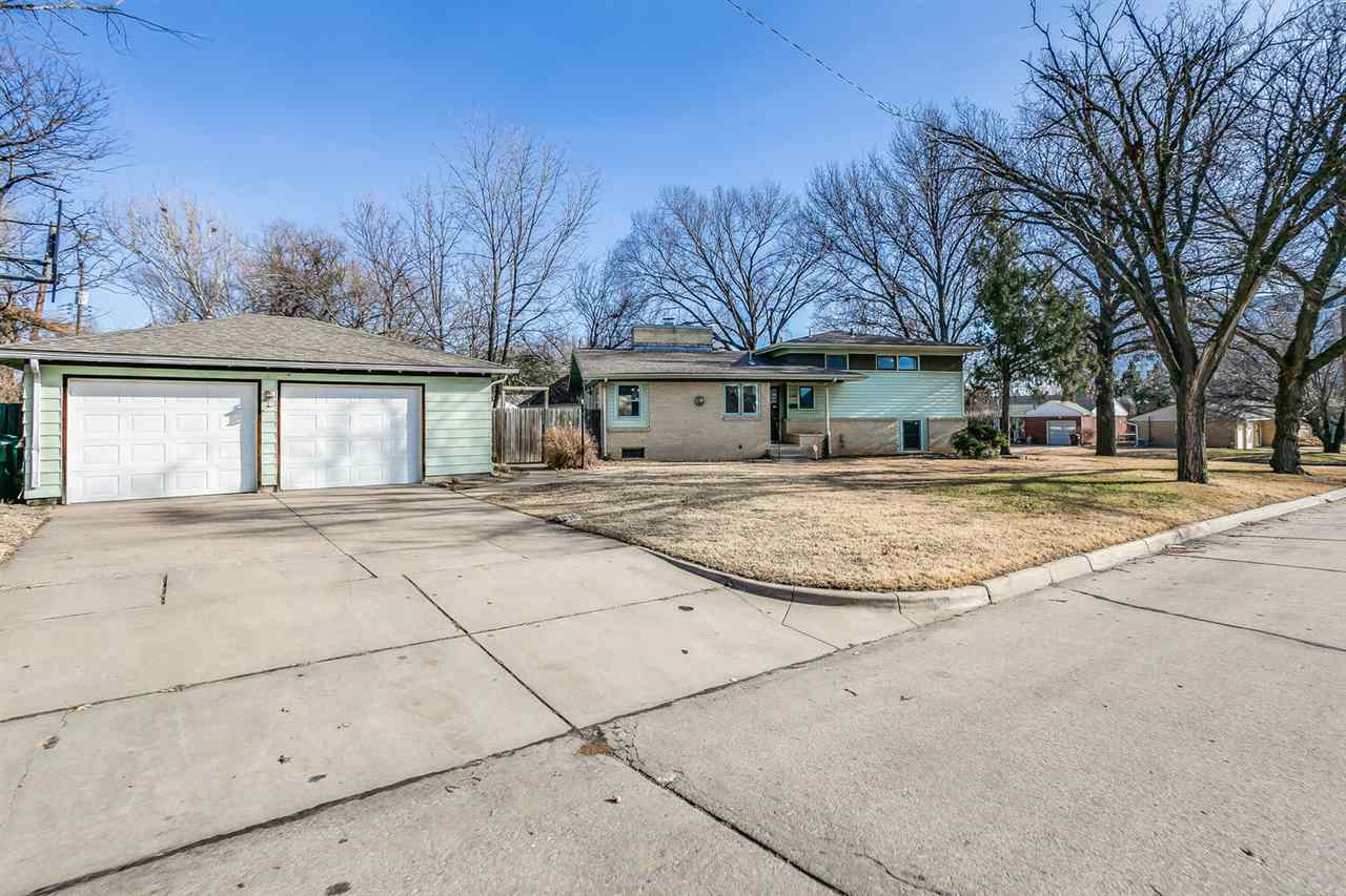 Fantastic 5 BEDROOM 2.5 BATH home with oversized 2 CAR GARAGE. This magnificent, mid-century home si