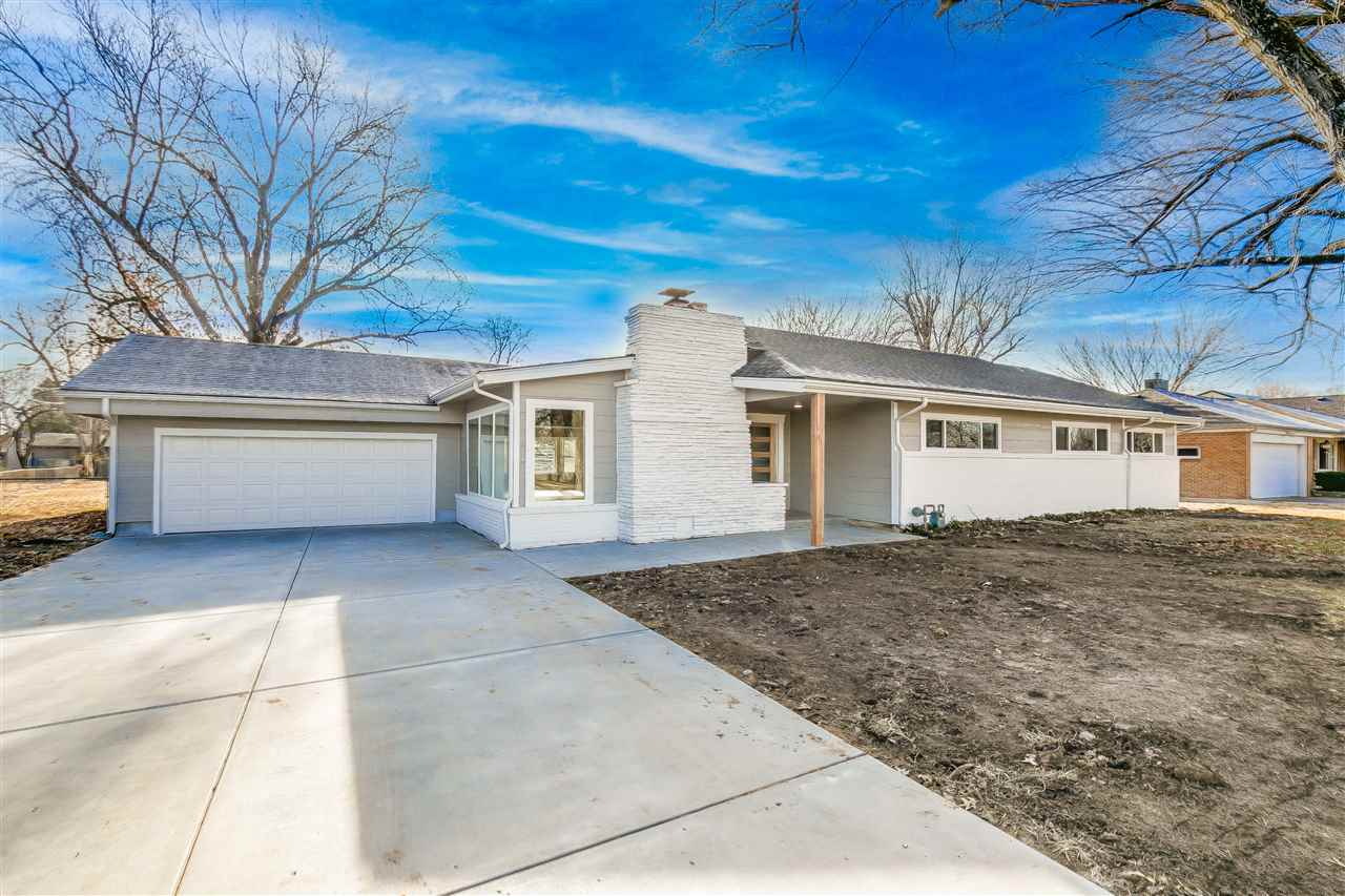Absolutely stunning zero entry ranch on over a 1/2 acre.  Welcome to this completely remodeled custo
