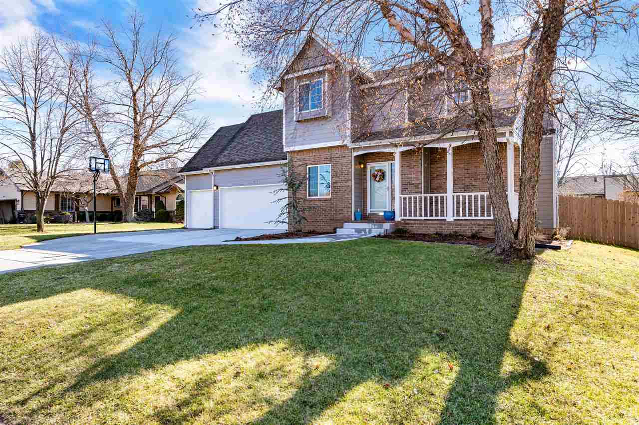This home is beautifully situated in a mature Derby neighborhood with several trees and great neighb