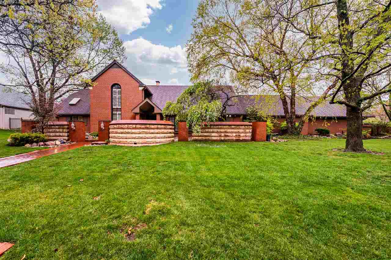 Stunning 1 1/2 story situated on a private corner lot in the well established Vickridge neighborhood