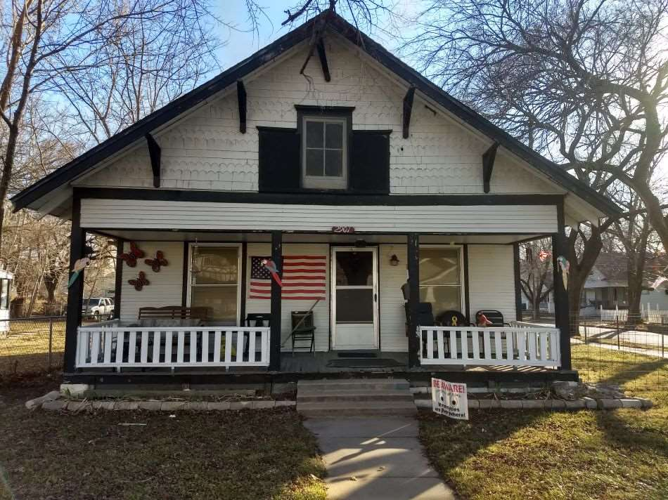 This bungalow is located in a nice neighborhood and has a large backyard.