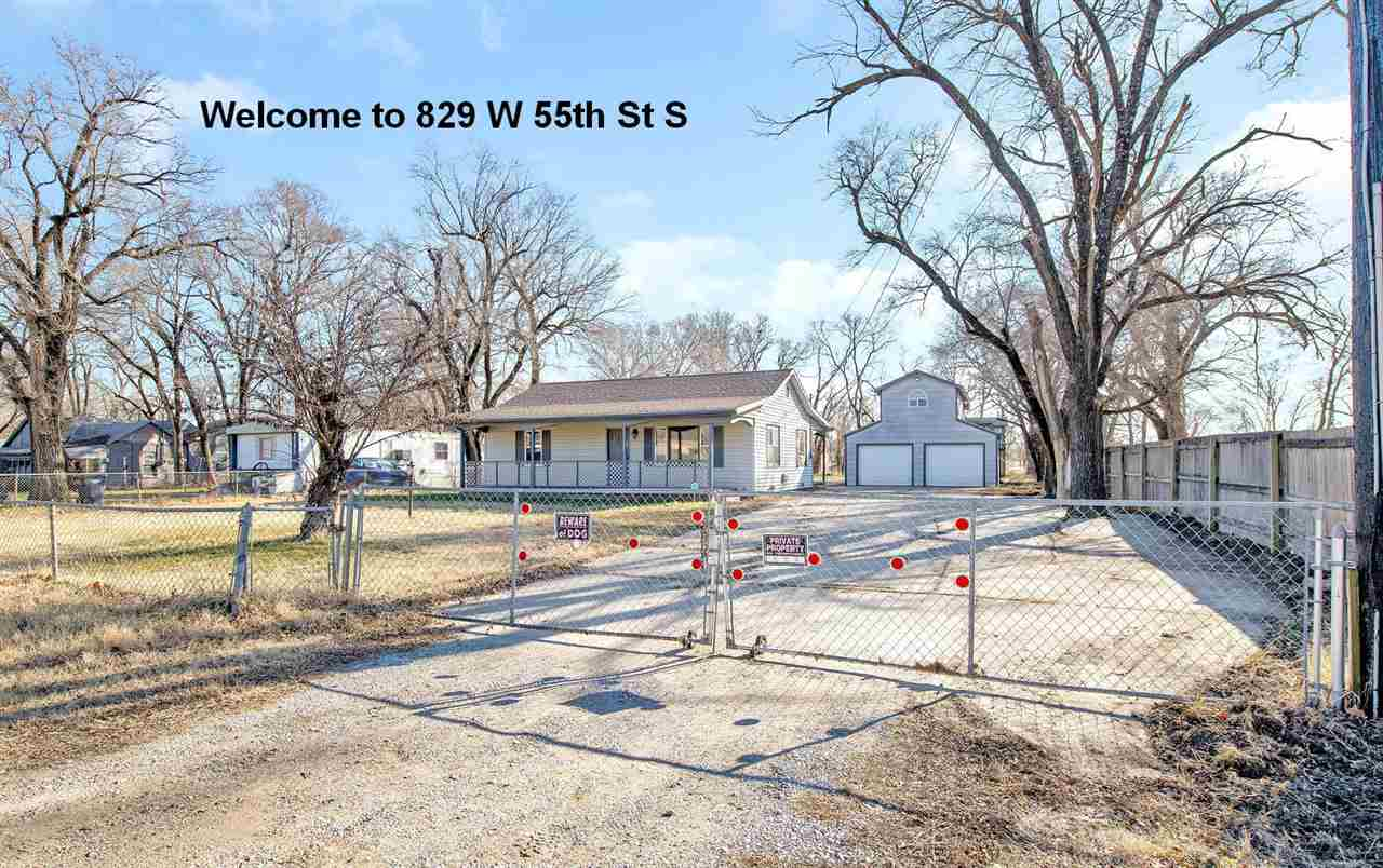 Property with a lot of potential! Located on a large lot that is completely fenced with entry gate i