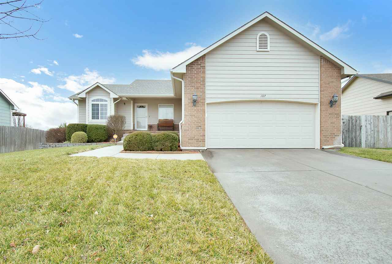 Welcome home to Derby! Beautifully landscaped with a spacious front porch and fenced back yard, this