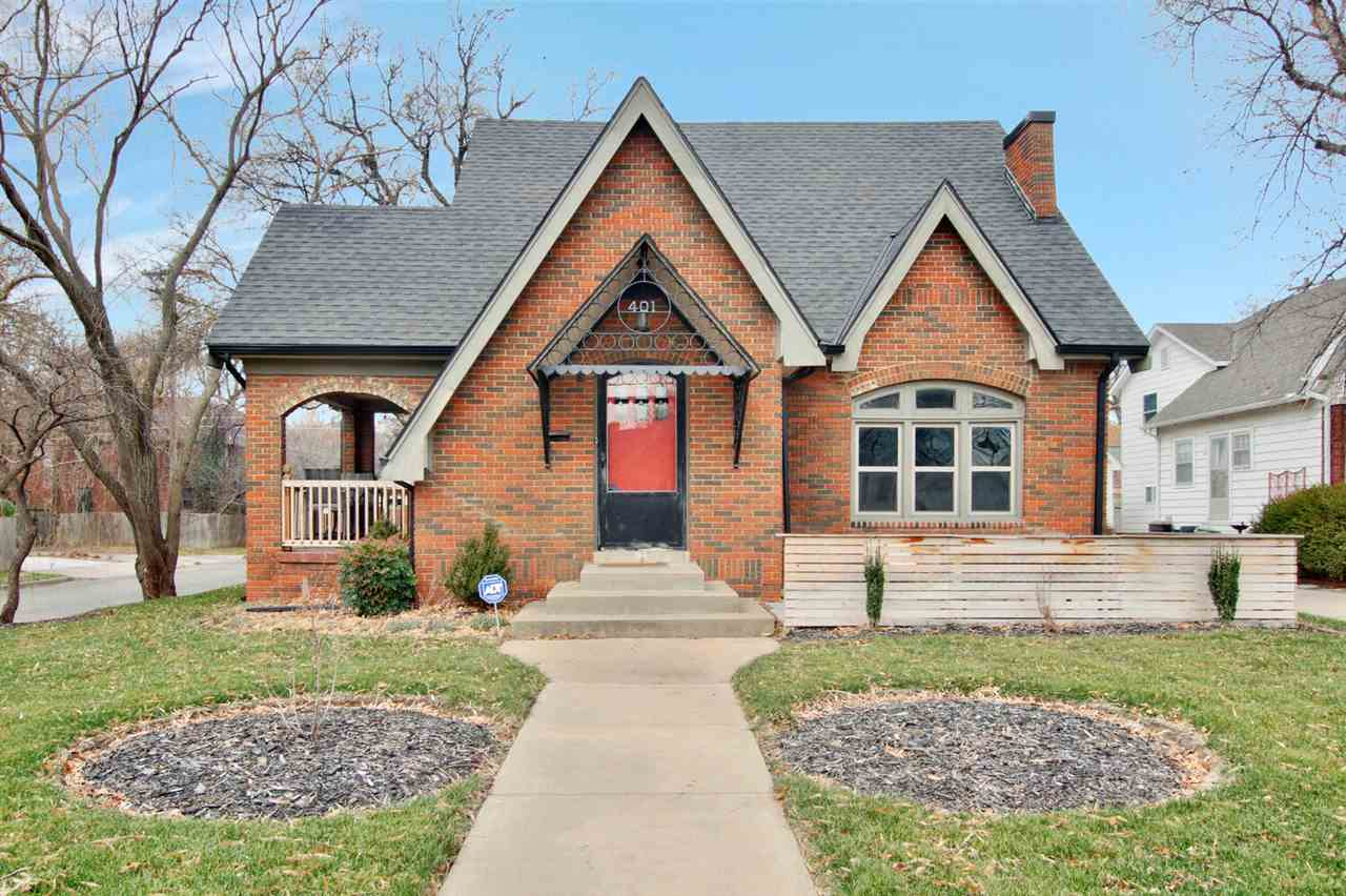 Welcome home to this beautiful bungalow in the College Hill area! This full brick, two story updated