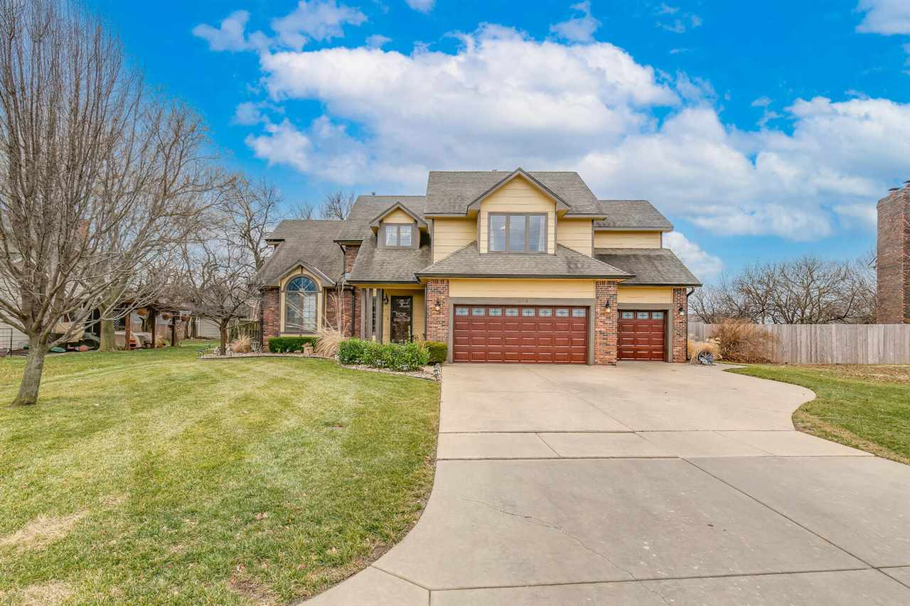 This beautiful home with great curb appeal has many features. As you walk in, you are greeted with v