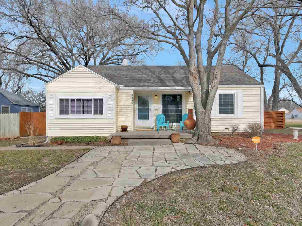Adorable home on a large lot with mature trees has been beautifully updated. Flagstone walkway leadi