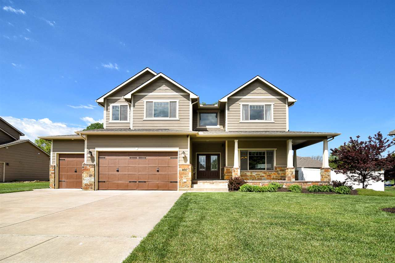 Magnificent Southeast Wichita 2-story home with upgrades everywhere!!  Professional landscaping and