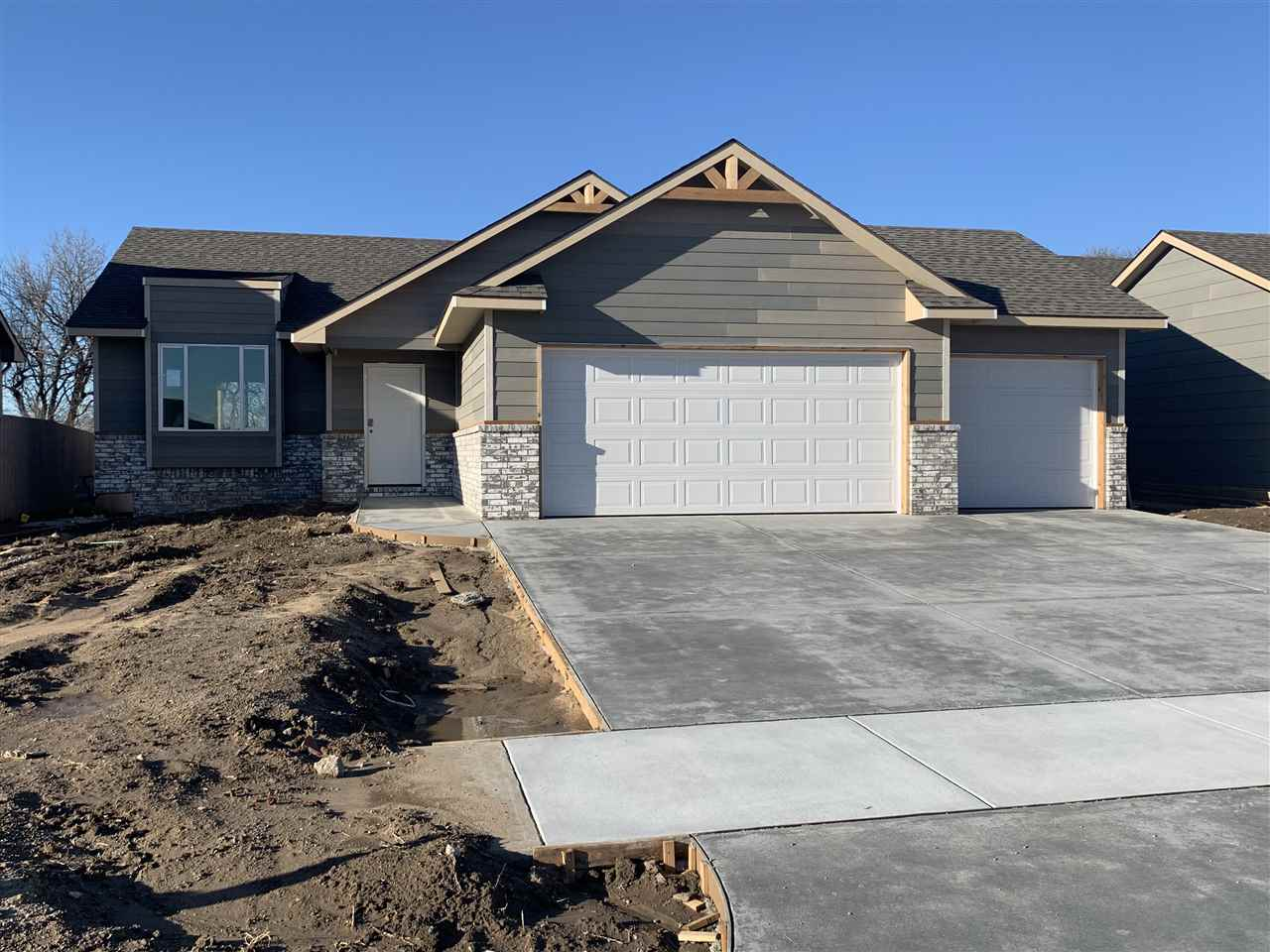 Welcome home! This 4 bedroom, 3 bathroom home, with kitchen island, full finished basement, 3 car ga