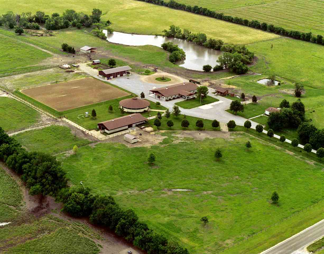 This luxury ranch has much to offer on it's sprawling 79+/- acres.  Show Barn (front building), Mare