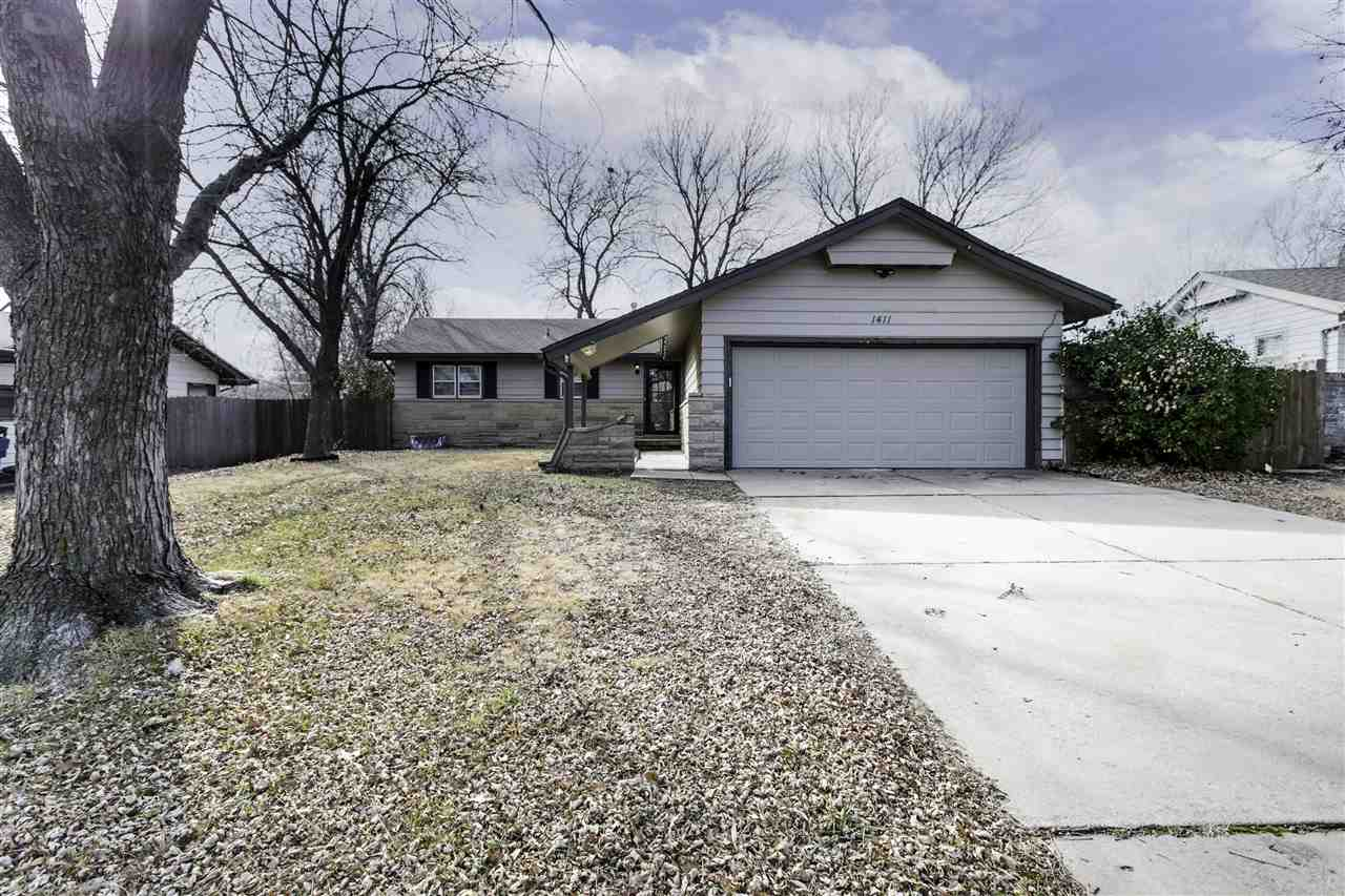 Welcome home to this beautifully remodeled ranch in the Derby school district! As you pull up to the