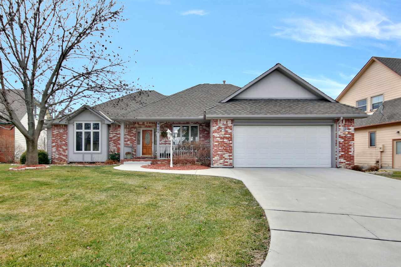 Your dream home awaits you, on the 13th hole of Tallgrass Country Club, in the highly desired neighborhood of Shannon Woods at Tallgrass!  The minute you step into this Immaculate Ranch home, you will be impressed with all of the fabulous upgrades, and stunning custom finishes throughout! The main level features a large open floor plan, with a spacious formal dining room, vaulted ceilings, large ceiling to floor windows providing an abundance of natural light, and wonderful views of the Golf course, neutral paint, and new carpet!  The living room and and Gourmet Kitchen share a cozy gas fireplace!  The newly upgraded Gourmet Kitchen is complete with a Large Custom Granite Island, and eating bar, Granite Countertops, beautiful Tarkett  floors, gorgeous custom wood Cabinets, and backsplash, stainless steel appliances, large dinette area, and under cabinet lighting!   Just off the kitchen step out to the Large Covered composite deck, overlooking the plush landscaped yard, offering breathtaking views of the Golf Course, Perfect for entertaining! The main floor Laundry is located just off of the Kitchen and has additional storage.  In addition the main floor boasts a Luxurious large Master Suite with walk-out deck, a perfect place to start your day with a fresh cup of coffee, double sink granite vanities, large walk in tile shower, new lighting, spacious walk-in closet, and a fantastic temperature controlled heater.  Two large bedrooms with spacious closets, full bath, and a half bath!  The finished walk-out basement showcases a  huge family room, perfect place to enjoy movie, and game nights,  two additional bedrooms, with spacious closets, wet bar, gas fireplace, and a full bath, and large storage room. This fabulous home features new main floor carpet, new covered composite deck, upgraded gourmet kitchen with new stainless steel appliances, upgraded Master Bath, new gutters, and fresh new paint throughout!  This home is a showstopper, and offers golf course living at