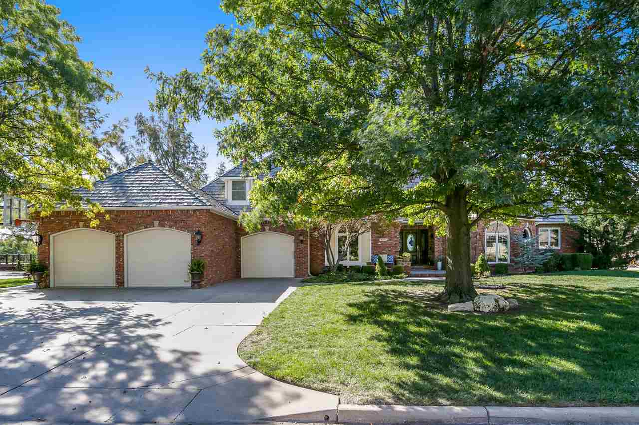 Great curb appeal welcomes you into this gorgeous full brick home. Located on one of Wichita's best