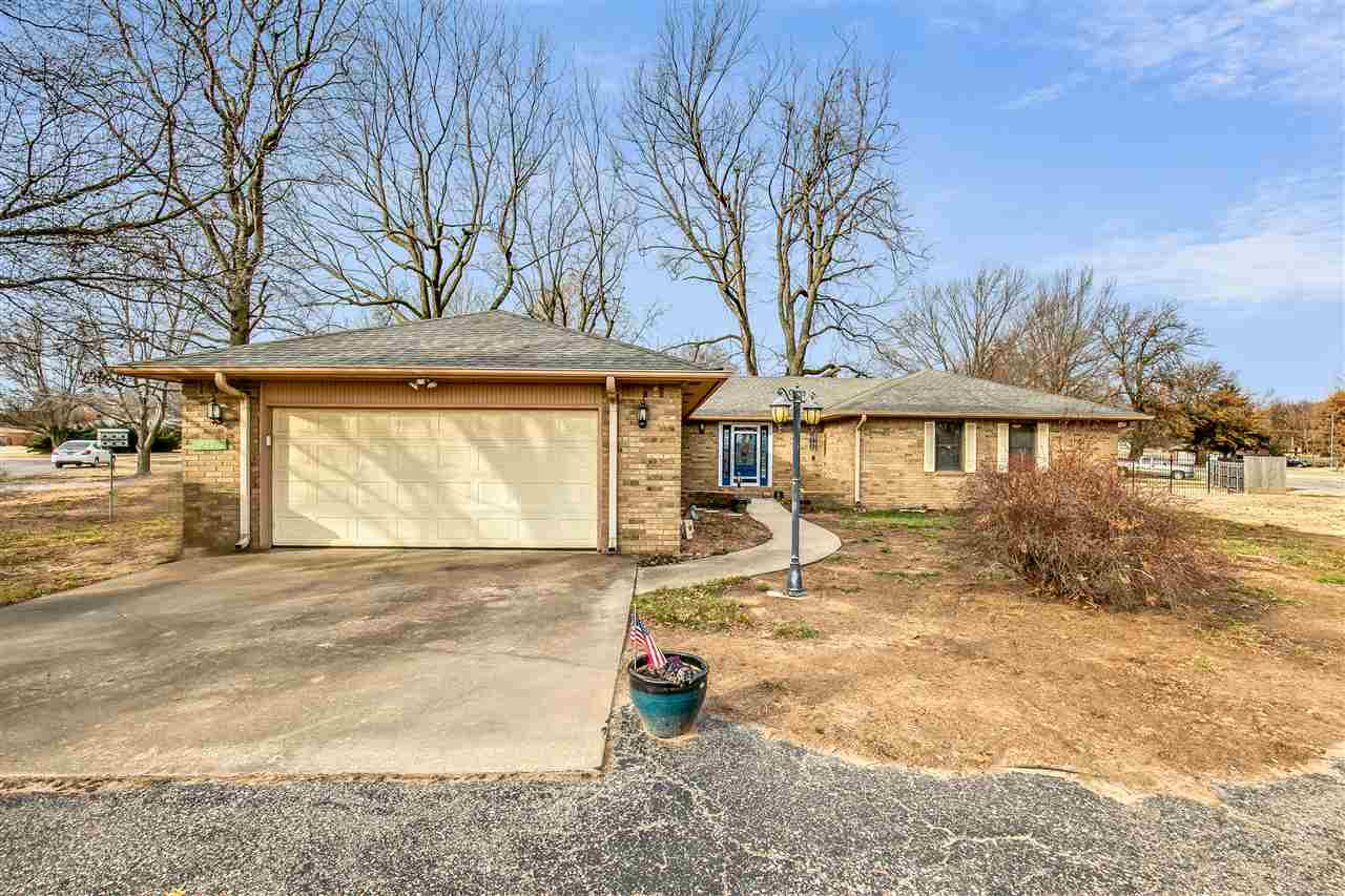 LOCATION, GORGEOUS HIGH END KITCHEN, AND ENDLESS UPDATES! This home is everything you have been looking for and more! This Beautiful brick ranch has 3 bedrooms 2 baths and over 2380 Sq Ft. Updates include new roof, completely remodeled kitchen, new flooring, new custom light fixtures, new stained glass front door and new sliding patio doors and the list goes on and on! The kitchen is stunning with high-end finishes that include granite countertops, NEW appliances and large island with eating bar open to the family room! Added bonus the family room has a built in wet bar perfect for having a drink after a long day. Enjoy family dinner in the spacious dining room complete with built-ins to house and showcase all of your special dishes and décor .  Off the dining room is the large family room which makes this home perfect for hosting and entertaining! Down the hall you will find spacious master suite complete with double vanity, double closets, separate soaker tub and stand up shower. Additionally, you will find two more nice sized bedrooms, hall bathroom and attached two car garage! Outside you will find a large backyard, deck perfect for grilling, detached garage and storage building!  This home has so much to offer and you will not want to miss it! Call listing agent today to schedule your private showing!