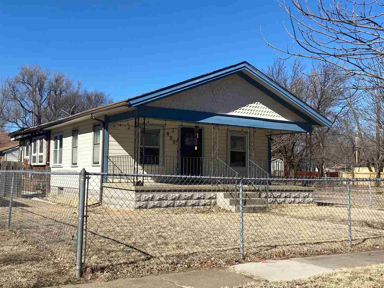 Cute ranch plan just minutes from downtown Wichita! Home sits on a corner lot and with fenced backya