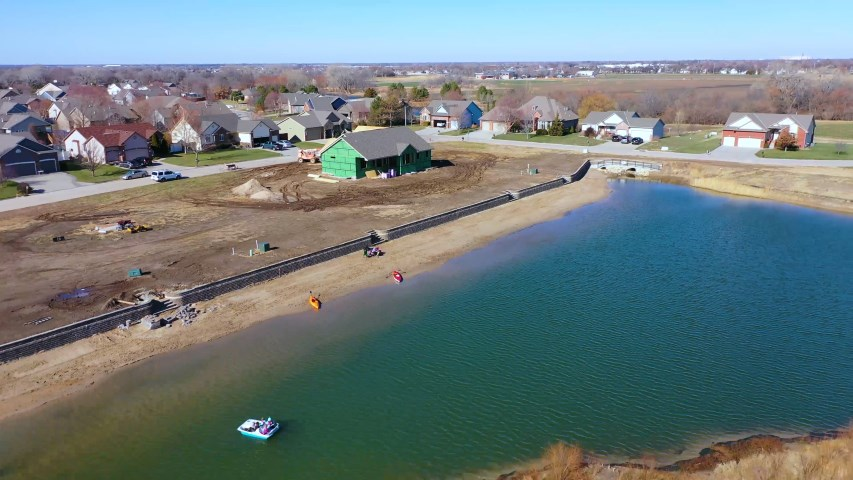 OWN YOUR OWN BEACH!  Enjoy shaded afternoons and glorious sunrises over the lake from this large cov