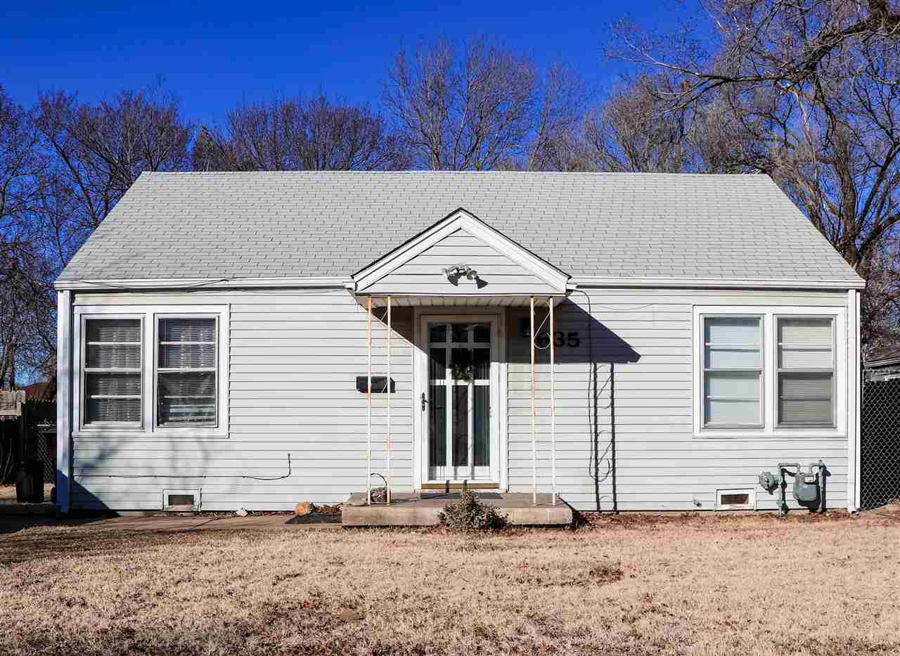 Come see this adorable 2 bed 1 bath home that's situated adjacent to Friends University on a quiet s