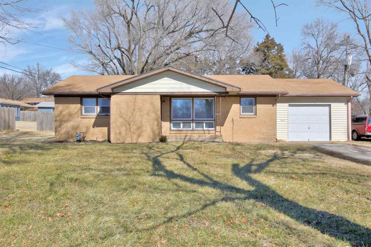 Sitting on 1/2 acre, you will love this darling 3 bed, 1 bath home with 3 car garage in Derby. Full