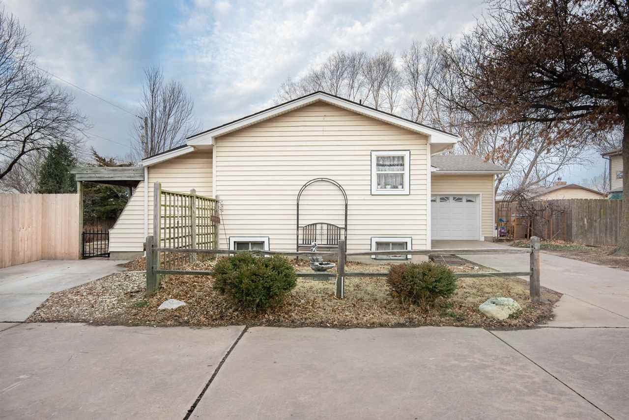 MOVE IN READY 3 BEDROOM RANCH HOME TUCKED BACK IN A QUIET AREA!  WALK INTO A LARGE OPEN PLAN ON THE
