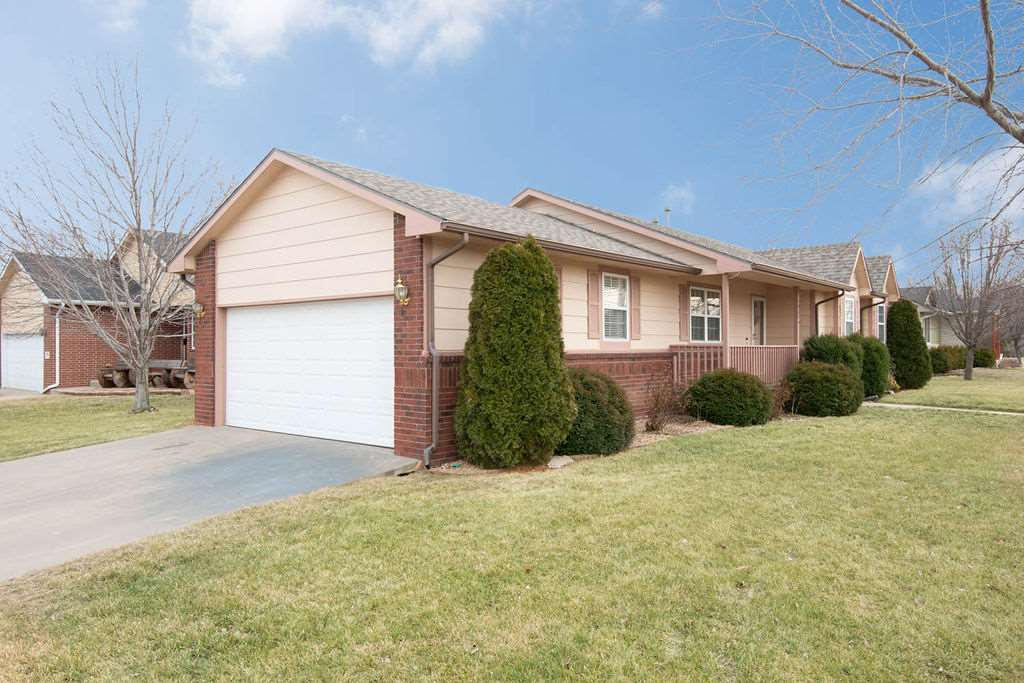 Corner lot with newly updated kitchen, fresh interior paint and luxury vinyl flooring! Tucked in a q